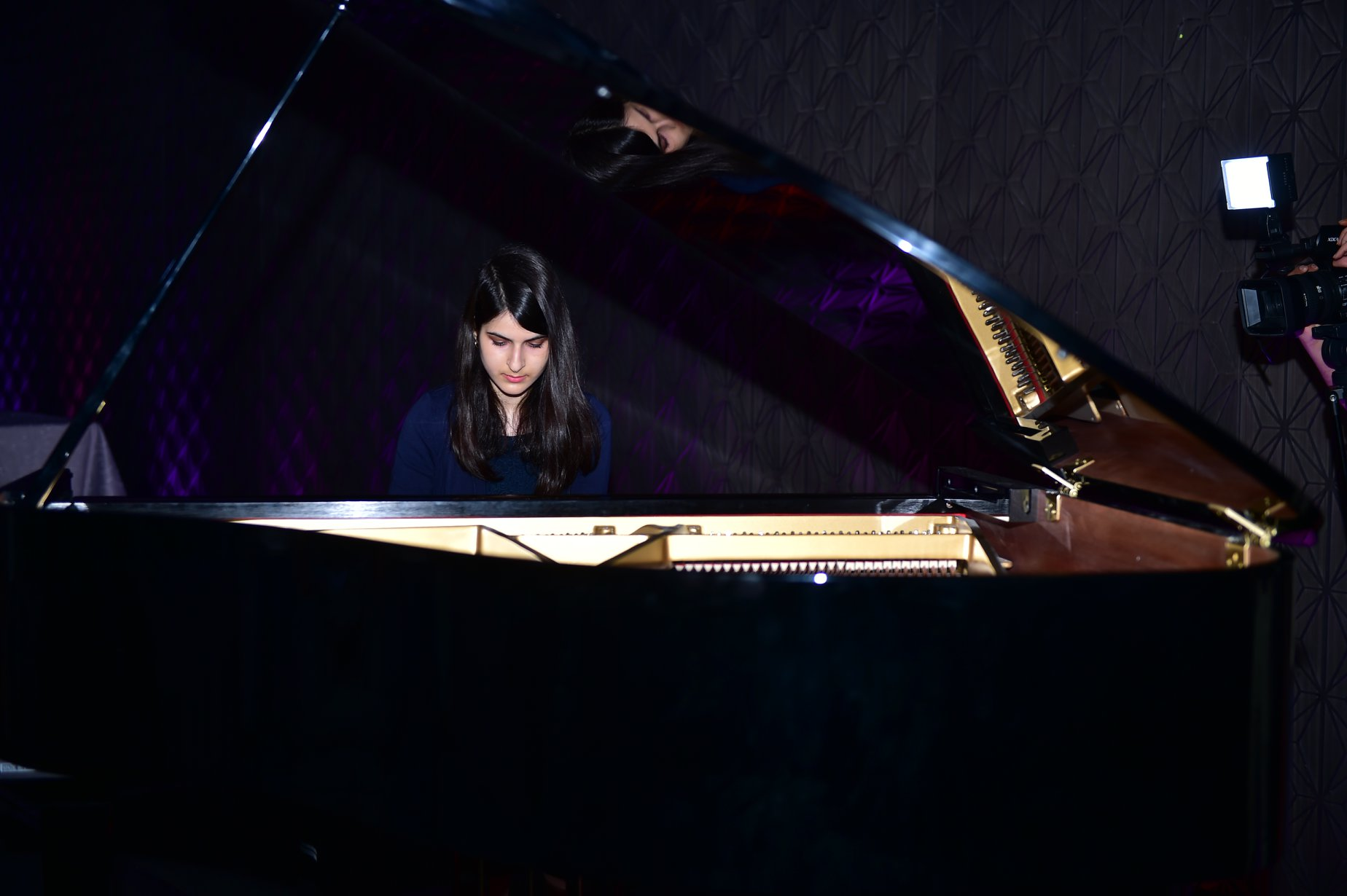 Lulwa Al Shamlan, Year 12 student and one of the youngest Inspiring Kuwaitis in our book, playing the Appassionata sonata, 3rd movement by Beethoven on the piano at the launch of Those Who Inspire Kuwait ©Those Who Inspire